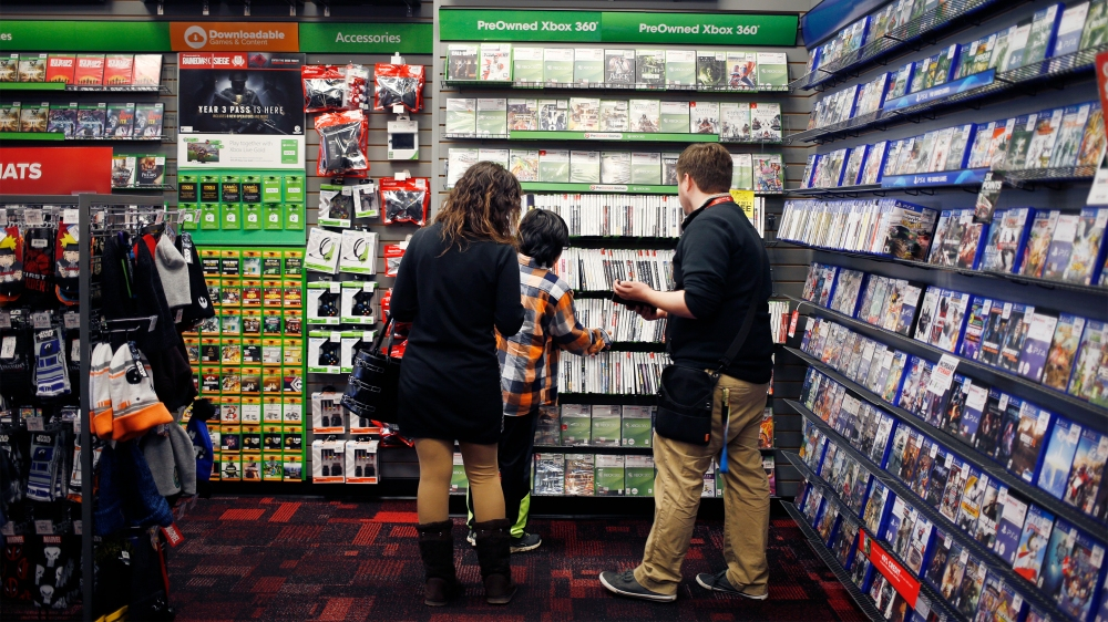 GameStop Employee Helping a Parent